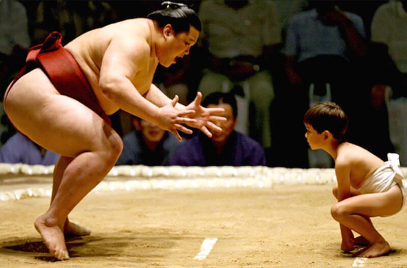 Barechested SUMO Wrestlers vs Children
