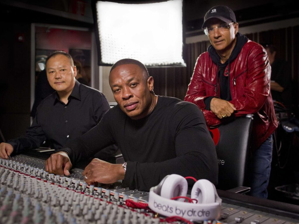 Barechested Dr Dre doesn't hoard his money, and he doesn't blow it all on extravagant items.